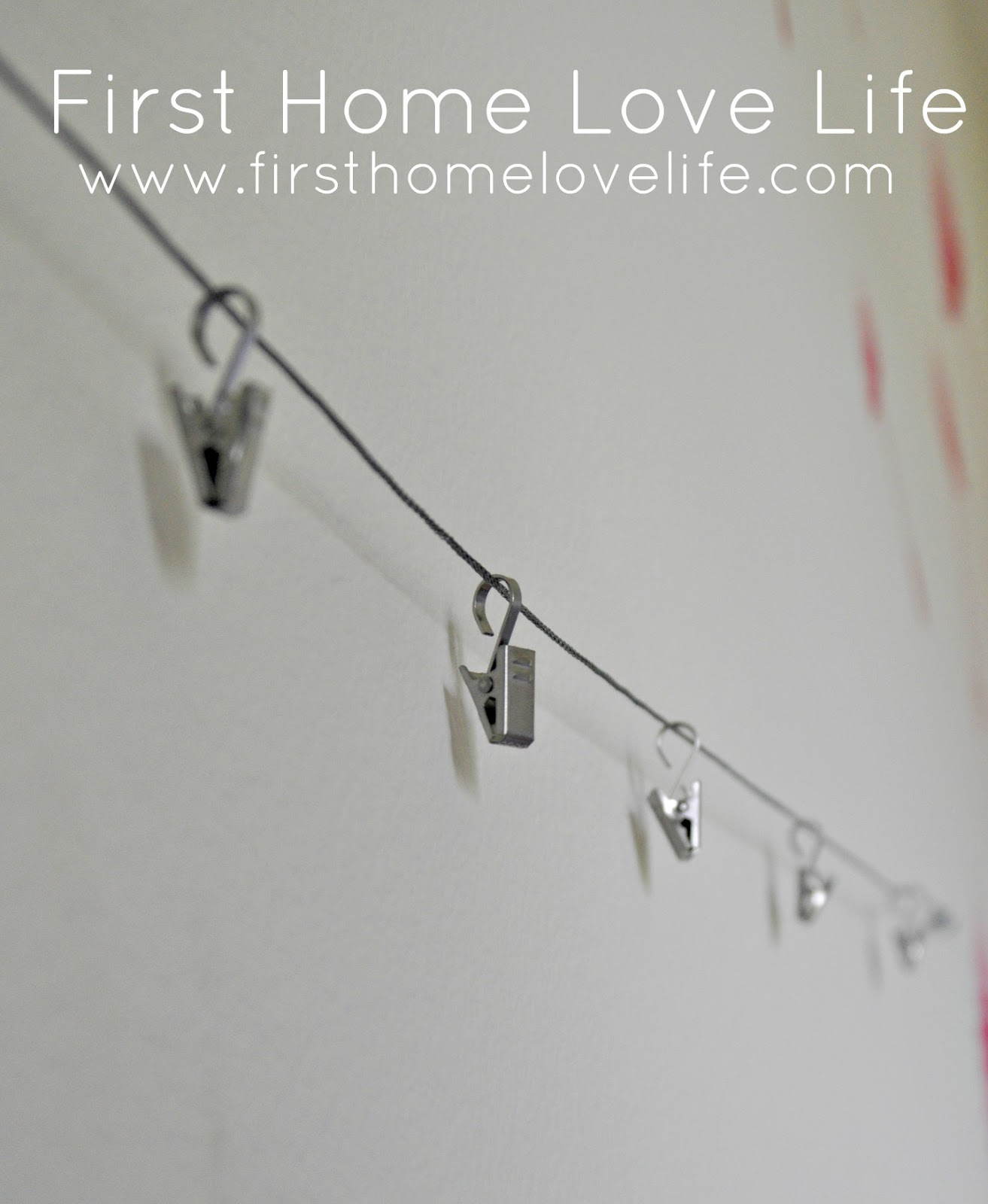 Hang your child 39 s heartwork first home love life for Hang photos from wire