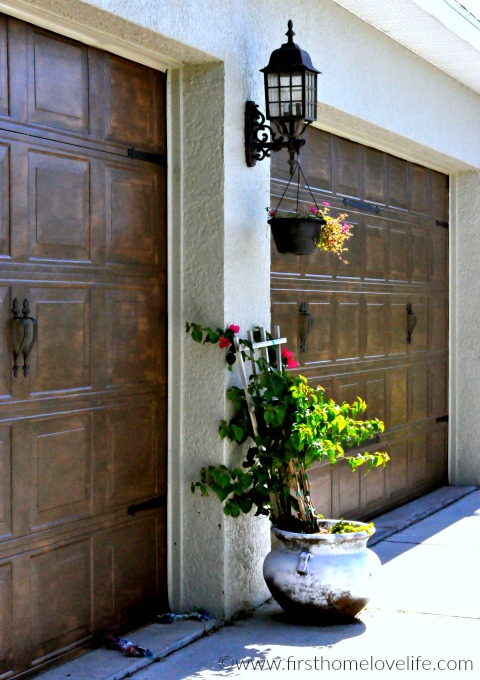 beautiful wood painted garage doors via www.firsthomelovelife.com