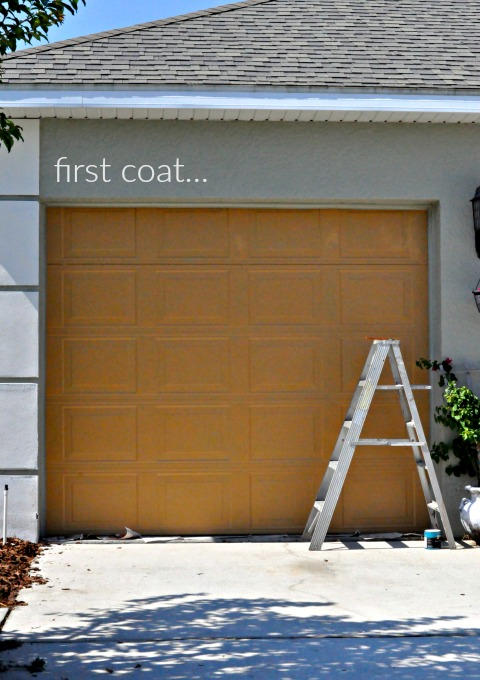 first coat using behr burnished caramel on the garage via firsthomelovelife.com