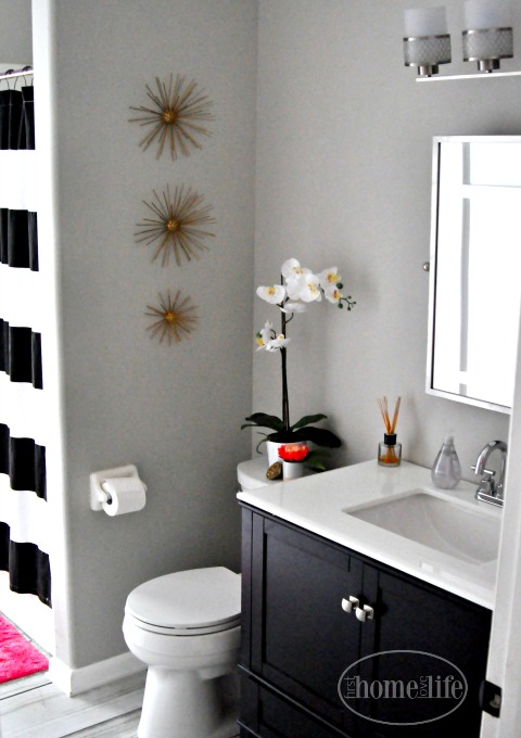 espresso bathroom vanity in gray bathroom via firsthomelovelife.com