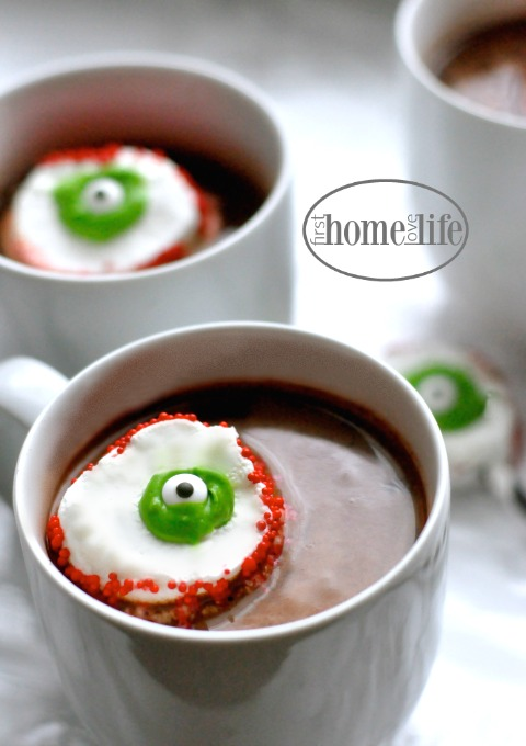 floating eyeballs made out of marshmallows in hot chocolate via firsthomelovelife.com