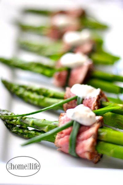 filet mignon wrapped asparagus appetizer | perfect finger food for the holidays via firsthomelovelife.com