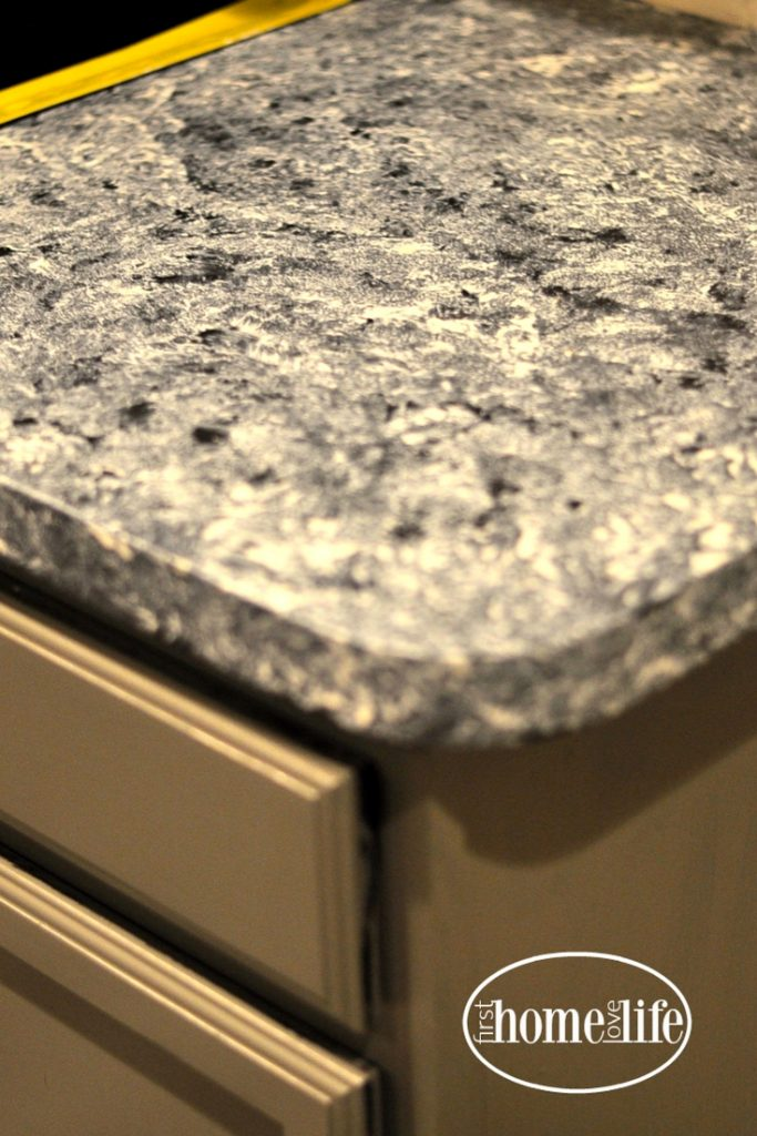 DIY inexpensive kitchen upgrade - how to paint formica counter tops to look like marble granite via firsthomelovelife.com